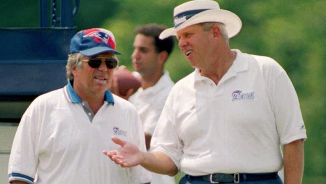 Patriots owner Robert Kraft and coach Bill Parcells converse during the team's 1995 training camp, a year before New England won the AFC.