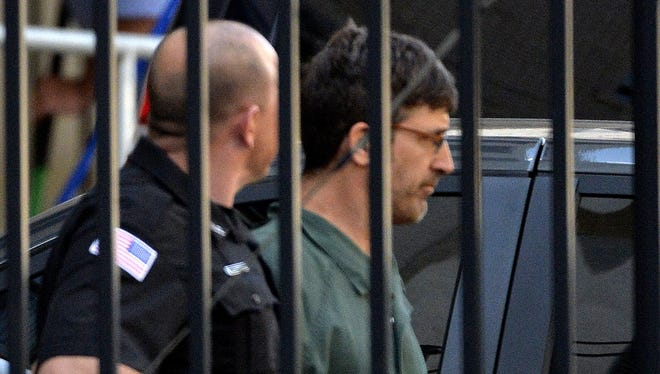 Glendon Scott Crawford, 49, of Galway, N.Y., leaving the federal courthouse in shackles after being arraigned Wednesday  in Albany, N.Y., for allegedly plotting to build and use an X-ray weapon to kill Muslims and other 'enemies of Israel.'