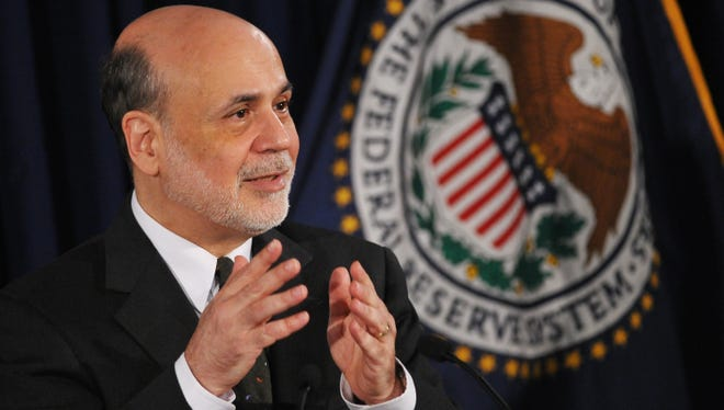 Fed Chairman Ben Bernanke speaks during a press conference following a meeting of the Federal Open Market Committee on Wednesday at the Federal Reserve Board Building in Washington.