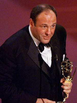 This September 10, 2000, photo shows actor James Gandolfini accepting his award lead actor at the Emmys.