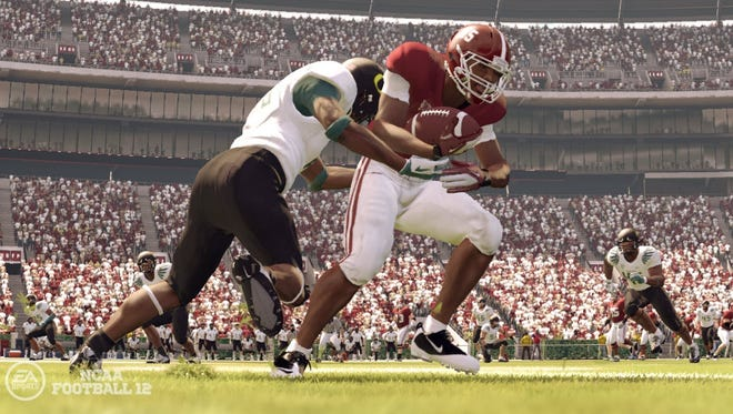 "In this screen grab image provided by EA Sports, an Oregon Ducks defender brings down an Alabama player in the video game ""NCAA Football 12."" Documents released Wednesday state that such likenesses to actual players are intentional."