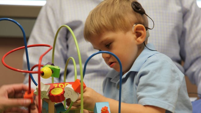 3-year-old Grayson Clamp is the first child in the U.S. to receive an auditory brainstem implant, also called ABI. With the implant, Grayson heard his dad talk for the first time.