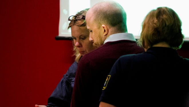 In this May 20, 2013 file photo, Pirate Bay founder Gottfrid Svartholm Warg, center, is escorted into the courtroom at Nacka District Court, in Stockholm, Sweden.