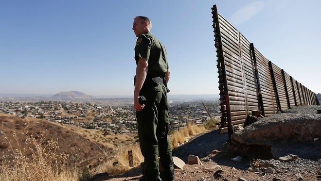 U.S. Border Patrol agent Jerry Conlin looks out over Tijuana, Mexico, near the old border wall along the U.S.-Mexico border on June 13 in San Diego.