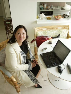 Patti Pao, 40, in her New York City apartment.  Pao is Vice President of brand management at David's Bridal in Conshohocken, PA.  She is doing some work from home.