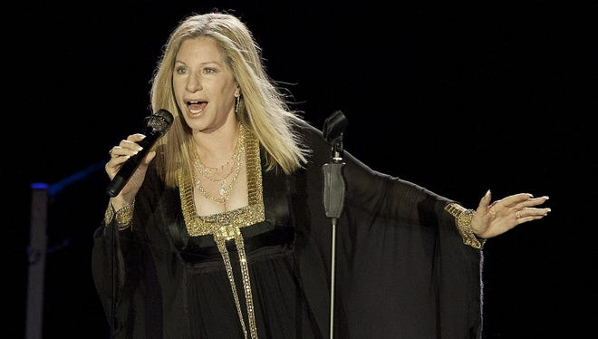 Barbra Streisand performs during her concert in Tel Aviv.