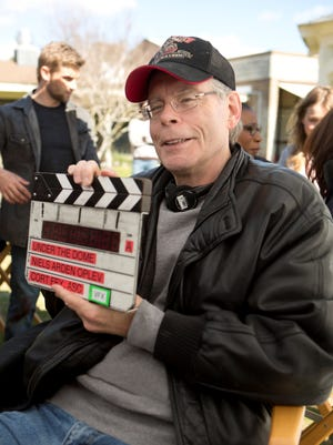 Author Stephen King sits on the set of 'Under the Dome,' a CBS series based on his 2009 book of the same name.