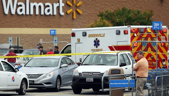 A man with a shotgun wounded three people in the parking lot of a Walmart in Greenville, N.C., after reportedly shooting one person outside a law firm across the street. Police later wounded the gunman.