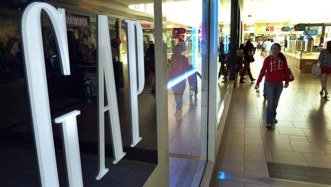 In this May 14, 2012, file photo, shoppers walk by the GAP store at a shopping mall in Peabody, Mass. Doris Fisher and her late husband Donald founded the Gap in San Francisco in 1969. Gap Inc. has grown to include Banana Republic and Old Navy brands, among others, and operates over 3,000 stores across the world. Fisher is is 142nd on Forbes's 2012 400 list. (AP Photo/Elise Amendola. File) ORG XMIT: NYBZ502