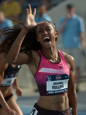 Brianna Rollins celebrates her American record in the 100-meter hurdles.