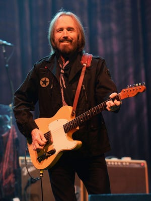 Tom Petty of Tom Petty and the Heartbreakers performs onstage at the Firefly Music Festival at The Woodlands of Dover International Speedway in Dover, Del.