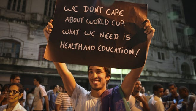 A man holds up a sign during a rally in Recife, Brazil.