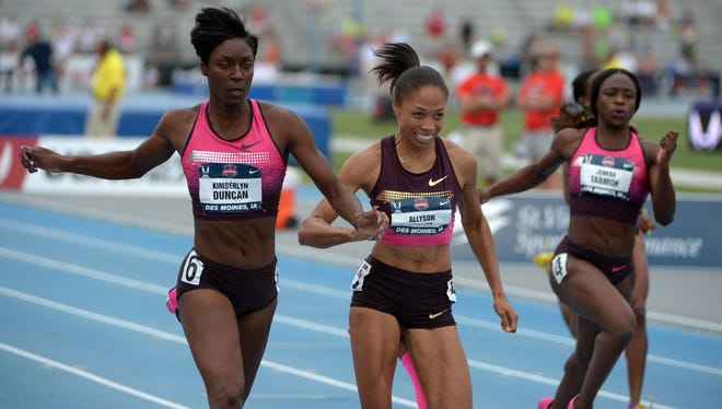 Kimberlyn Duncan, left, defeats Allyson Felix , center, and Jeneba Tarmoh to win the womens 200 meters in a wind-aided 21.80 at Drake Stadium.