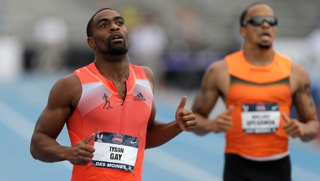 Tyson Gay, left, finishes the men's 200-meters in 19.74 seconds, best in the world this year. Wallace Spearmon, right, finished fourth at the U.S. Track and Field Championships in Des Moines.