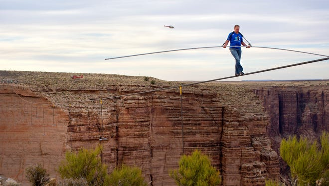 Nik Wallenda nears the completion of his 1,400-foot walk across a gorge near the Grand Canyon for Discovery Channel's 'Skywire Live with Nik Wallenda.'