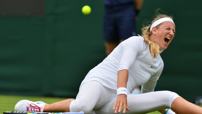The pain is evident on Victoria Azarenka's face after she slipped, twisted her knee and fell during the second set of her match against Maria Joao Kohler of Portugal.