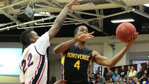 Kasey Hill, driving on Findlay Prep's Fallou Ndoye during his senior seasonat Monteverde (Fla.) Academy, was a second-team American Family Insurance ALL-USA selection this year.
