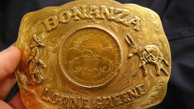 """A gold belt buckle bearing the late actor Lorne Greene's name and the Western series that he starred in, """"Bonanza,"""" is among items up for auction from Greene's personal collection."""