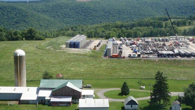 A farmhouse sits next to a fracking site near Tioga County, Pa.