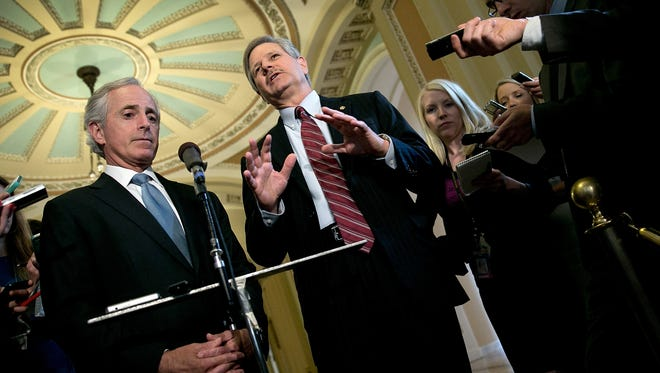 The Senate is scheduled to vote on an immigration amendment introduced by Sen. Bob Corker, R-Tenn., left, and Sen. John Hoeven, R-N.D., last week.