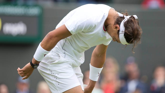 Rafael Nadal of Spain loses for in the first round of a major for the first time, falling in straight sets to Steve Darcis of Belgium.