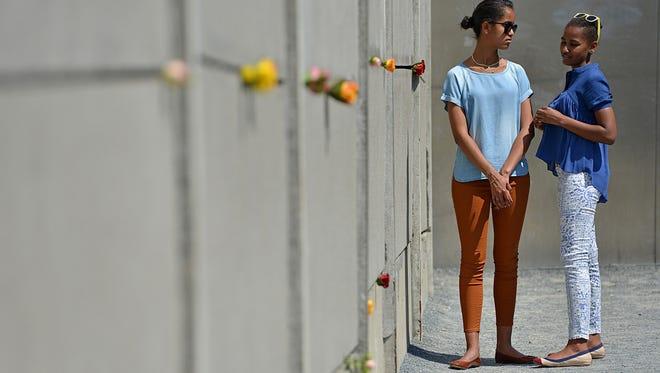 Malia and Sasha Obama visit the Berlin Wall memorial in Berlin on June 19.