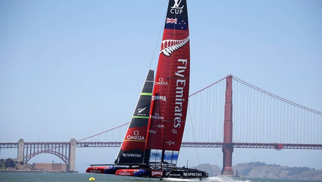 In this photo taken May 24, 2013, Emirates Team New Zealand trains for the America's Cup with the Golden Gate Bridge in the background in San Francisco.