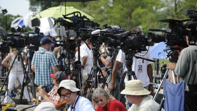 Reporters and photographers wait outside the Supreme Court on Monday.