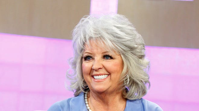 Paula Deen's contract with the Food Network ended after she admitted to using racial slurs .