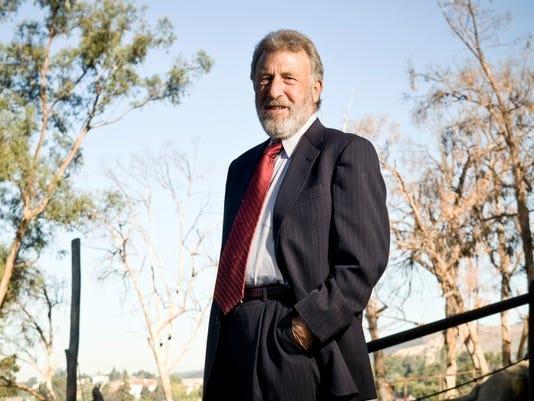 2c21a283551b Men s Wearhouse fires back at George Zimmer