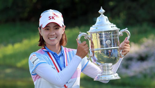 Na Yeon Choi of South Korea hoists the trophy after winning the 2012 U.S. Women's Open.
