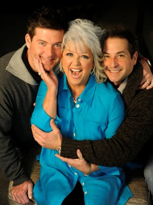 Paula Deen poses with sons Jamie (left) and Bobby (right) on Jan. 16, 2012.