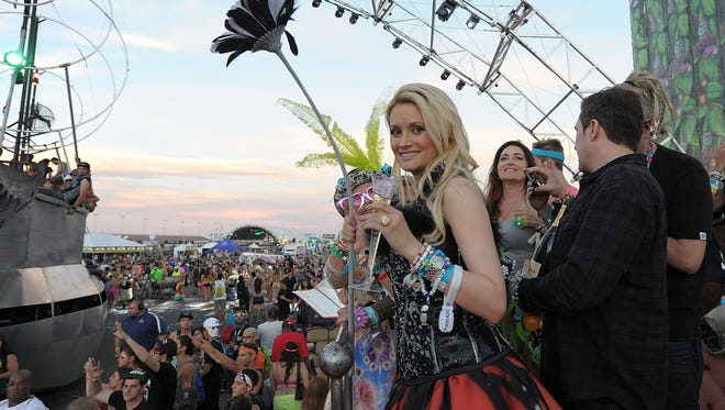 Holly Madison shows off her engagement ring shortly after Pasquale Rotella proposed during the 17th annual Electric Daisy Carnival at Las Vegas Motor Speedway on Sunday.