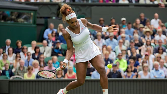 Serena Williams of the USA fires a forehand during her opening-round victory Tuesday against Mandy Minella of Luxembourg.