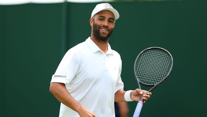 James Blake smiles after defeating Thiemo De Bakker in straight sets to end his four year Wimbledon losing streak.