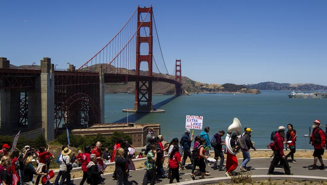 National Nurses United members and environmental activists protest against the Keystone XL pipeline June 20 near the Golden Gate Bridge in San Francisco.
