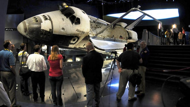 Space shuttle Atlantis awaits viewing by the public at the Kennedy Space Center Visitors Complex.