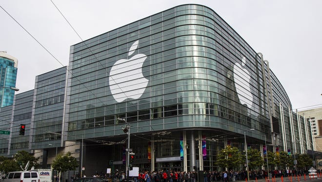 Attendees wait in line for the keynote address during Apple's annual developer conference in San Francisco.