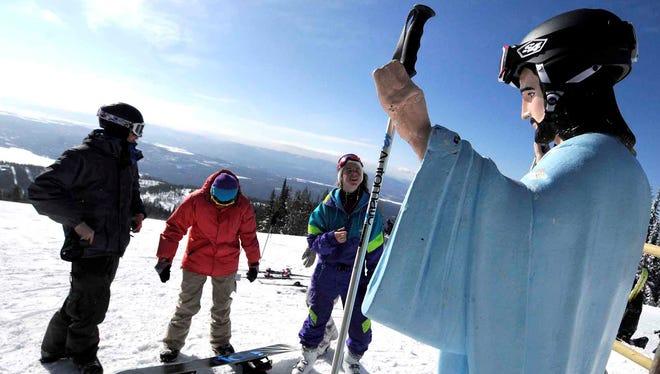University of Montana freshmen visit a statue of Jesus at Whitefish Mountain Resort  Whitefish, Mont., Feb. 20, 2011.
