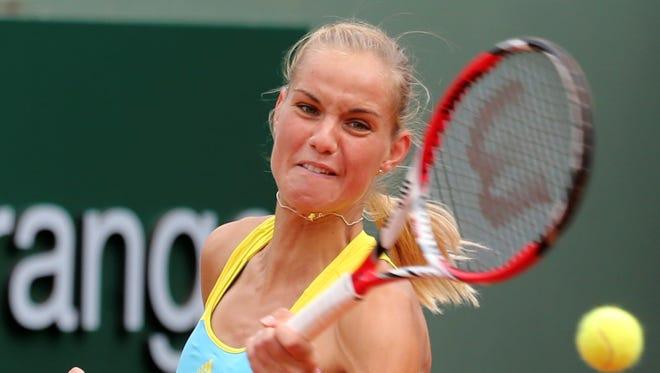 Arantxa Rus  lost her 17th consecutive main-draw, tour-level match Tuesday at Wimbledon.