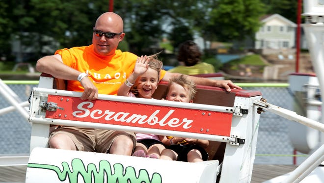 Todd Pekny rides the Scrambler with his children Campbell, 8, and Chase, 5, at Indiana Beach Amusement Resort on June 4, 2013.