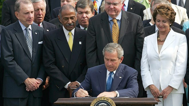 President Bush signs the renewal of the Voting Rights Act in 2006.