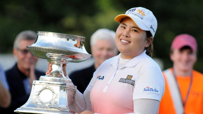 Inbee Park lifts the championship trophy after winning the Wegmans LPGA Championship, her second major title of the season.