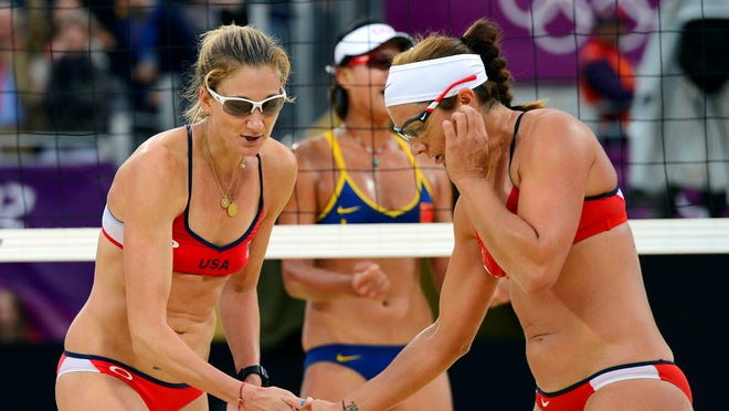 In a file photo from Aug 7, 2012, Kerri Walsh Jennings (left) and  Misty May-Treanor (USA) celebrate following a point against China's Chen Xue and  Xi Zhang in the women's semifinal match during the London Olympics at Horse Guards Parade.
