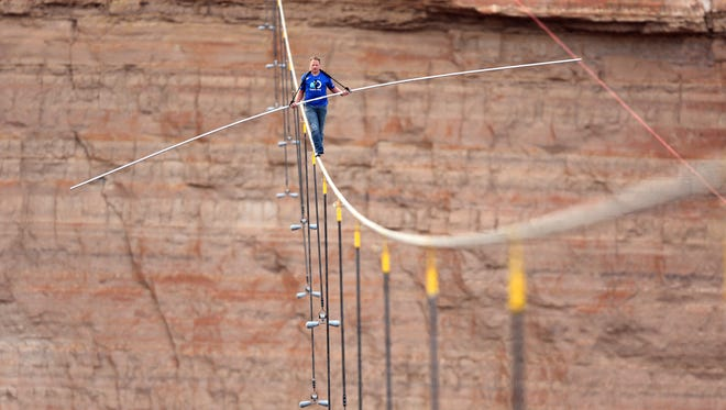 Nik Wallenda walks on a high-wire, nets Discovery 13 million viewers.