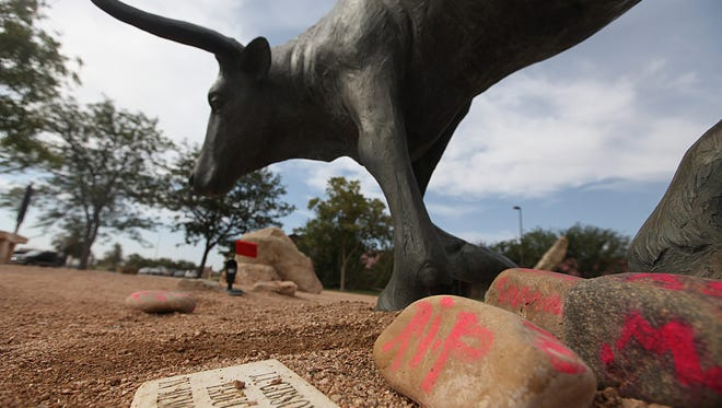 Memorials rest at the feet of a longhorn statue at the National Ranching Heritage Center in Lubbock, Texas, June 25, where 14-year-old Miguel Martinez died as the result of an accident.