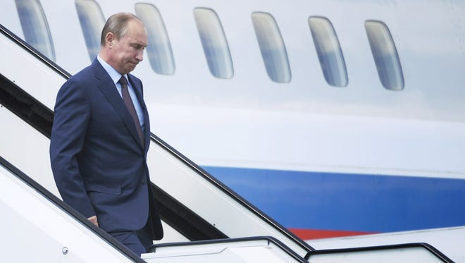 Russian President Vladimir Putin arrives in Turku, Finland, on June 25 where he met with Finnish President Sauli Niinistoe. Putin said NSA leaker Edward Snowden is staying in the transit lounge of the airport where he doesn't need a visa and has not officially crossed into Russia.