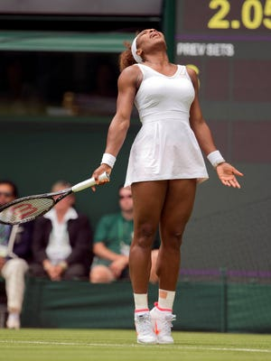 Serena Williams looks skyward during her first-round match Tuesday against Mandy Minella of Luxembourg. The opener went pretty well, a 6-1, 6-3 victory, but Williams said she was a bit rusty.