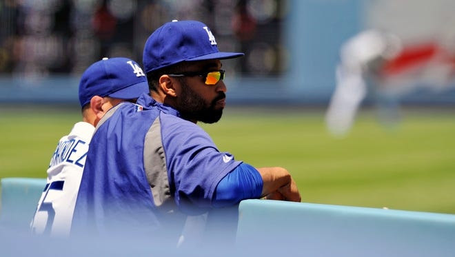 Los Angeles Dodgers center fielder Matt Kemp (27) watches game action in the second inning against the Atlanta Braves at Dodger Stadium.
