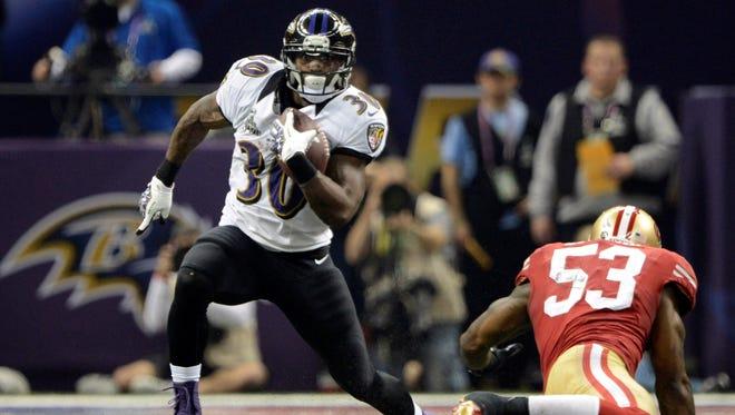 Baltimore Ravens running back Bernard Pierce (30) runs past San Francisco 49ers inside linebacker NaVorro Bowman (53) in Super Bowl XLVII.